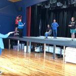 The cast gets direction from Christin Bossenberry at rehearsal this afternoon
